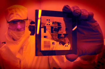 A researcher examining a photomask for a patterning sample at the Chapel Hill Analytical and Nanofabrication Laboratory at UNC-Chapel Hill. Credit: Dan Sears