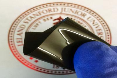 Stanford researchers have developed a thin polyethylene film that prevents a lithium-ion battery from overheating, then restarts the battery when it cools. The film is embedded with spiky nanoparticles of graphene-coated nickel. (Photo: Zheng Chen)