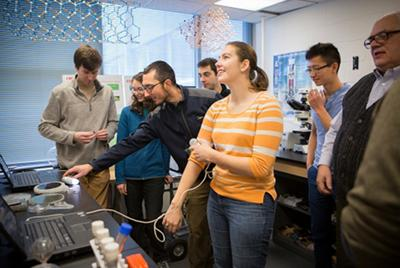 Lynn Rathbun, laboratory manager at the Cornell NanoScale Science and Technology Facility, shows engineering students how to set up demonstrations. - Lindsay France/University Photography