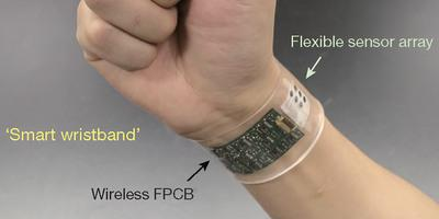 Photograph of a wearable FISA on a subject's wrist, integrating the multiplexed sweat sensor array and the wireless FPCB. (All photographs in this paper were taken by the authors.)