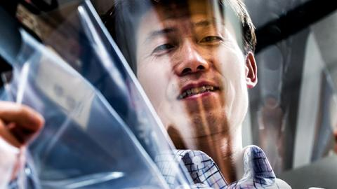 """L. Jay Guo, EECS Professor, shows a """"stainless"""" silver layer that his research group has created.Photo: Joseph Xu/Michigan Engineering Multimedia Content Producer, University of Michigan - College of Engineering"""